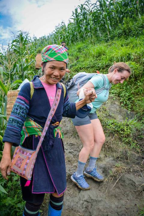 Hmong women helps you while trekking